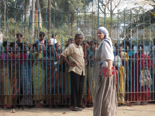 Sister Nathaniel at the gate where some of the poor are trying to get in to our Dispensary for food and medicine