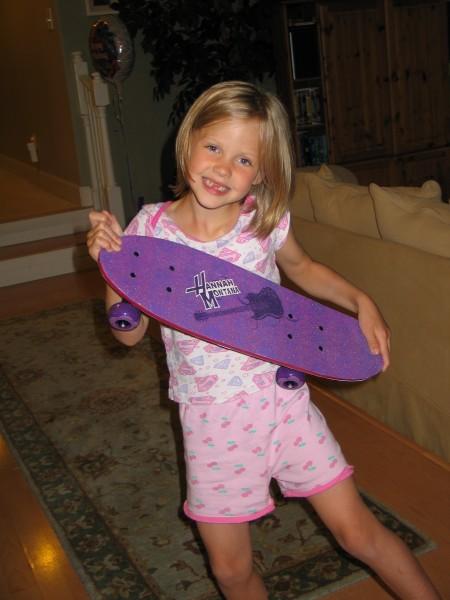 Zoe and her Hannah Montana Skateboard